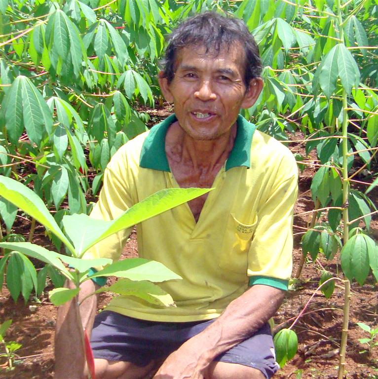 Farmer with his new seedlings